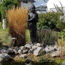 Stehender Buddha mit Topf, H 151 cm, schwarz antik