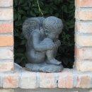 Sitzender Engel, H 36 cm, schwarz antik